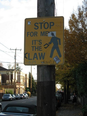 stop for me, it's the claw - graffiti on road sign